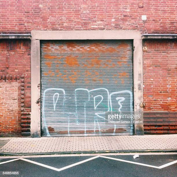 Graffiti On Closed Factory Shutter
