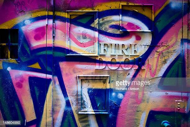 Graffiti on fire door in Degraves Lane.