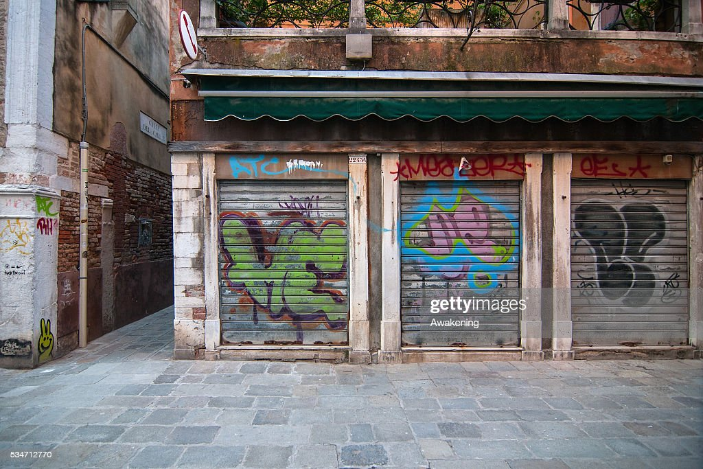 Graffiti on the walls and on the shutters is seen in a street on May 27, 2016 in Venice, Italy. In recent years, graffiti and street art has appeared in Venice, with some complaining that it is ruining the walls and palaces of the city.