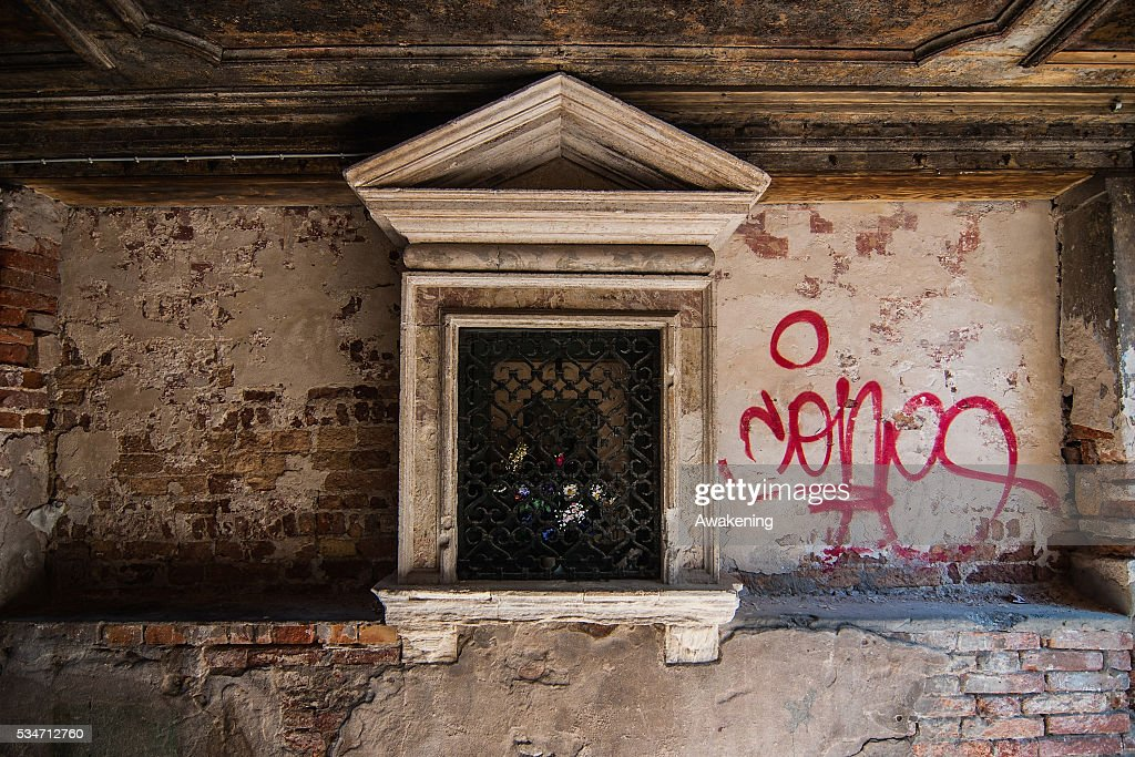 Graffiti on the walls of a street on May 27, 2016 in Venice, Italy. In recent years, graffiti and street art has appeared in Venice, with some complaining that it is ruining the walls and palaces of the city.