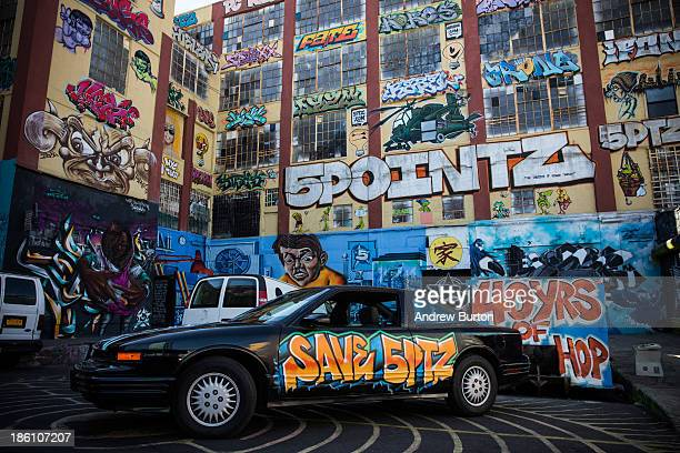 A graffiti painted car is parked in front of the 5 Pointz Building a landmark in the New York graffiti scene that has attracted artists from around...