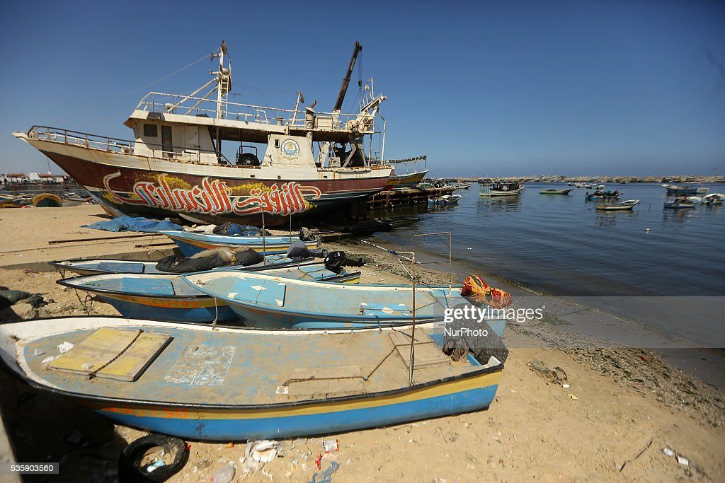 A graffiti painted in front of an old ship at Gaza seaport on May 30, 2016.