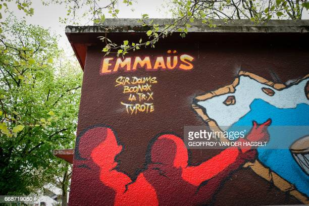 A graffiti reading 'Emmaus' is seen in the HLM housing estate of AulnaysousBois a commune in the SeineSaintDenis department in the northeastern...