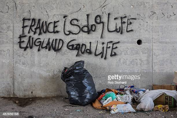 Graffiti reading 'France is dog life England good life' is seen on a wall close to a make shift camp near the port of Calais on August 1 2015 in...