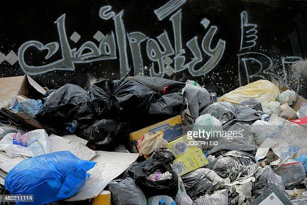 'Tomorrow is a better day' is seen sprayed above piles of rubbish in Beirut on July 28 as the Lebanese capital and the surrounding region continue to...