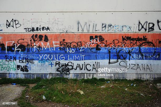 A graffiti sign with the Serbian flag is seen near the Ibar River during elections in Mitrovica North to elect the Mayor on February 23 2014 in...