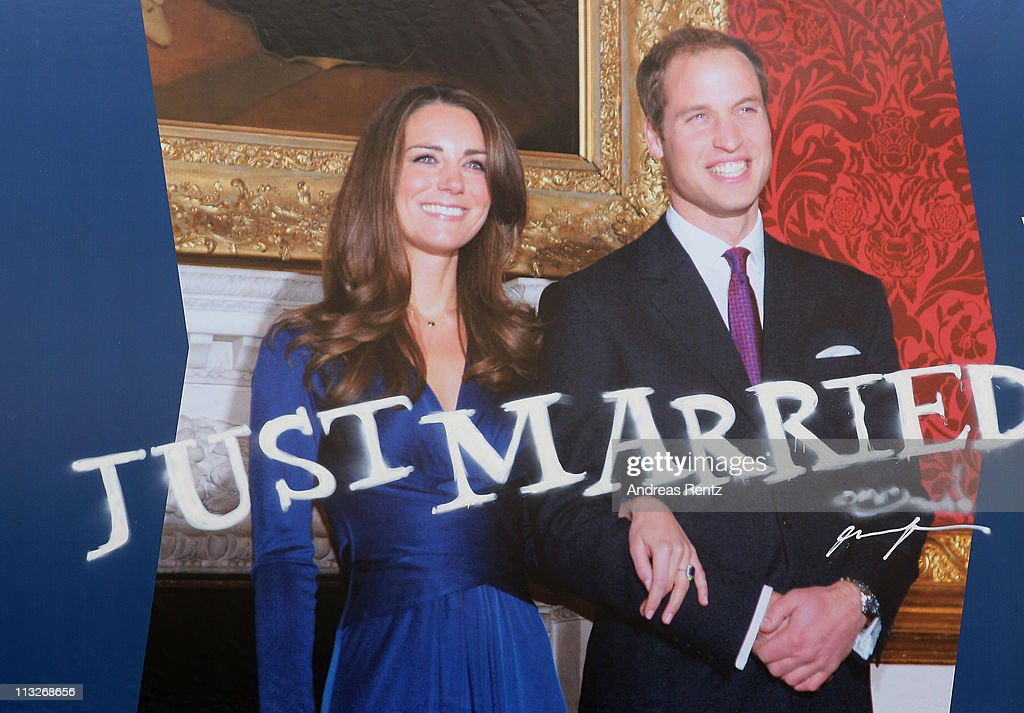 A graffiti spray 'Just Married' below a giant poster of the the Royal Highnesses Prince William, Duke of Cambridge and Catherine, Duchess of Cambridge is pictured at the British embassy on April 29, 2011 in Berlin, Germany. The wedding of Britain's Prince William and his fiancee Kate Middleton will be celebrated at Westminster Abbey in London on April 29, 2011.
