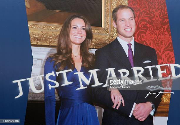 A graffiti spray 'Just Married' below a giant poster of the the Royal Highnesses Prince William Duke of Cambridge and Catherine Duchess of Cambridge...