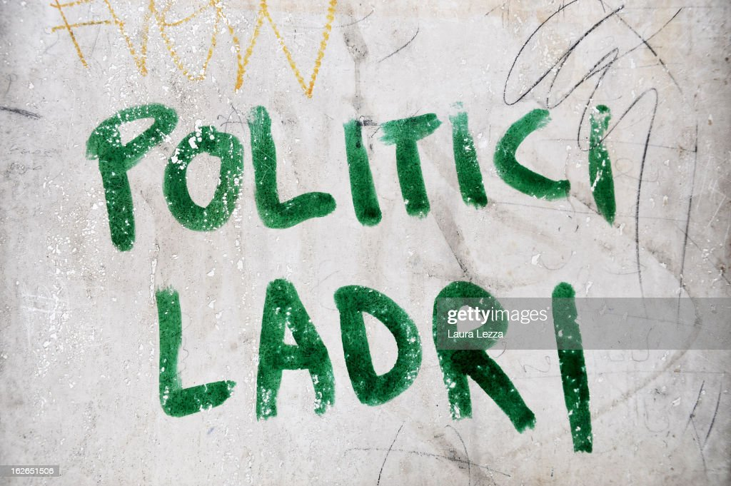 Graffiti sprayed on a wall reads 'Politicians Thieves' on February 25, 2013 in Livorno, Italy. Italians have today headed to the polls for the second and final day of voting in Italy's general election. According to reports, early projections show Silvio Berlusconi's centre-right coalition slightly ahead of Pier Luigi Bersani's centre-left in Senate, contradicting exit polls.