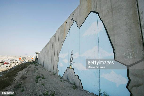 BANK AUGUST 6 A graffiti titled 'Art Attack' made by the British guerrilla graffiti artist Banksy is seen on Israel's highly controversial West Bank...