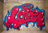 awesome graffiti of the word love sprayed on a wall
