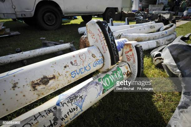 Graffitied and stickered secondhand front bumpers for a VW Type 2 Splitscreen Transporter for sale in the trade stands area at Vanfest festival in...