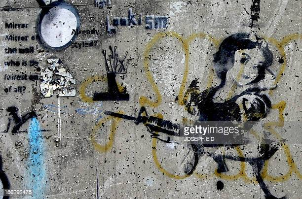 A graffito of Snow White holding a machine gun is painted on a wall at a street in the Lebanese capital Beirut on October 30 2013 AFP PHOTO/JOSEPH EID
