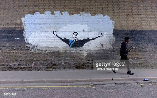 A graffitti mural on a wall outside the ground after the Sky Bet Championship match between Millwall and Huddersfield Town at The Den on August 17...