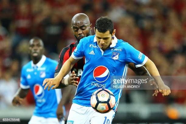 Grafite from Brazil's Atletico Paranaense struggles for the ball with Pedro Franco from Colombia's Millonarios during a Libertadores Cup football...