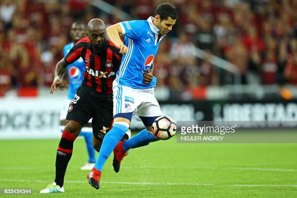 Grafite from Brazil's Atletico Paranaense struggles for the ball with Pedro Franco of Colombia's Millonarios during a Libertadores Cup football match...