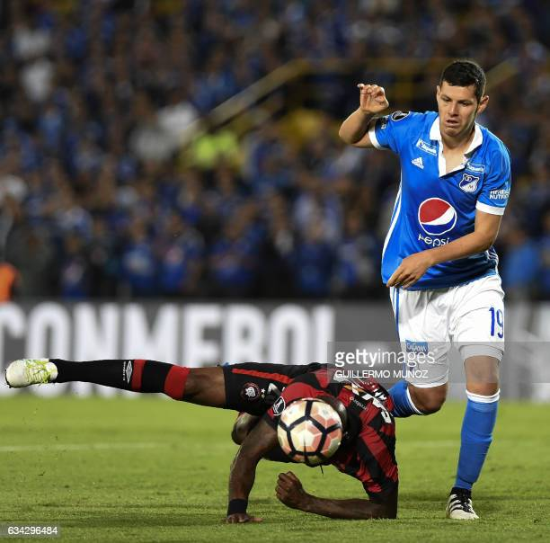 Grafite from Brazil's Atletico Paranaense vies for the ball with Pedro Camilo Franco of Colombia's Millonarios during a Libertadores Cup football...