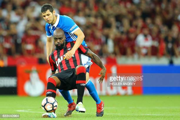 Grafite of Brazil's Atletico Paranaense struggles for the ball with Pedro Franco of Colombia's Millonarios during a Libertadores Cup football match...