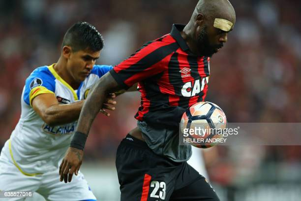 Grafite of Brazil's Atletico Paranaense struggles for the ball with Ramon Ortigoza of Paraguay's Deportivo Capiata during their Libertadores Cup...