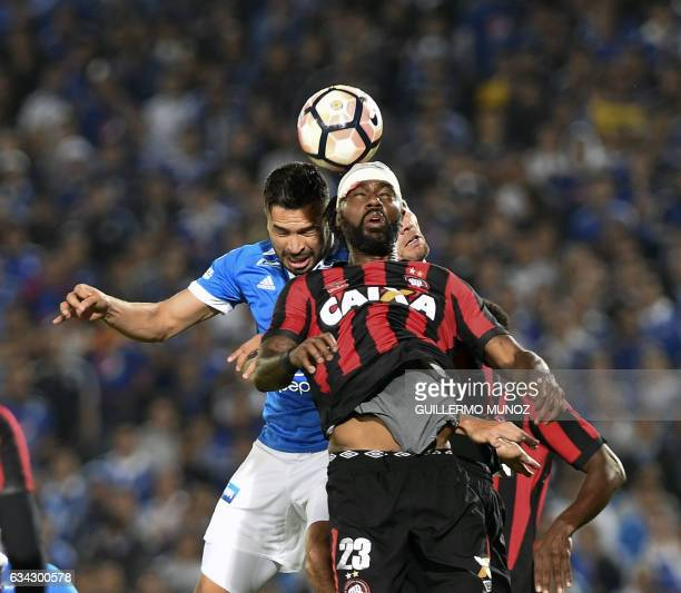Grafite of Brazil's Atletico Paranaense vies for the ball with Ayron Del Valle of Colombia's Millonarios during a Libertadores Cup football match at...