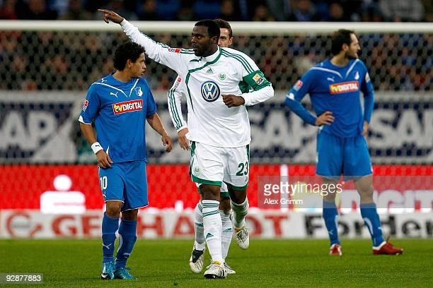 Grafite of Wolfsburg celebrates his team's second goal as Carlos Eduardo of Hoffenheim reacts during the Bundesliga match between 1899 Hoffenheim and...