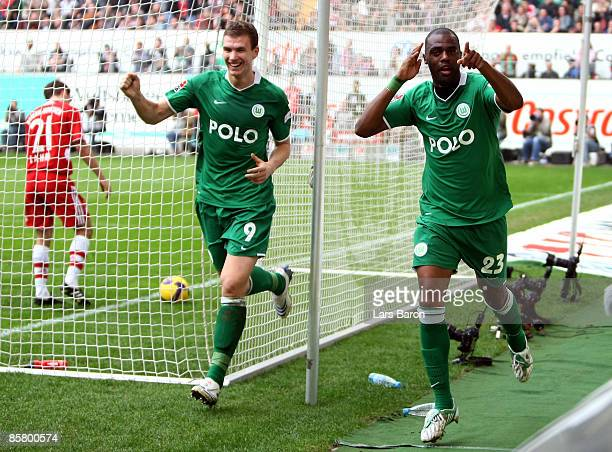 Grafite of Wolfsburg celebrates scoring his team's fourth goal next to team mate Edin Dzeko during the Bundesliga match between VfL Wolfsburg and FC...