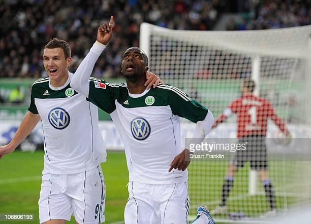Grafite of Wolfsburg celebrates scoring the first goal with Edin Dzeko during the Bundesliga match between VfL Wolfsburg and FC Schalke 04 at...