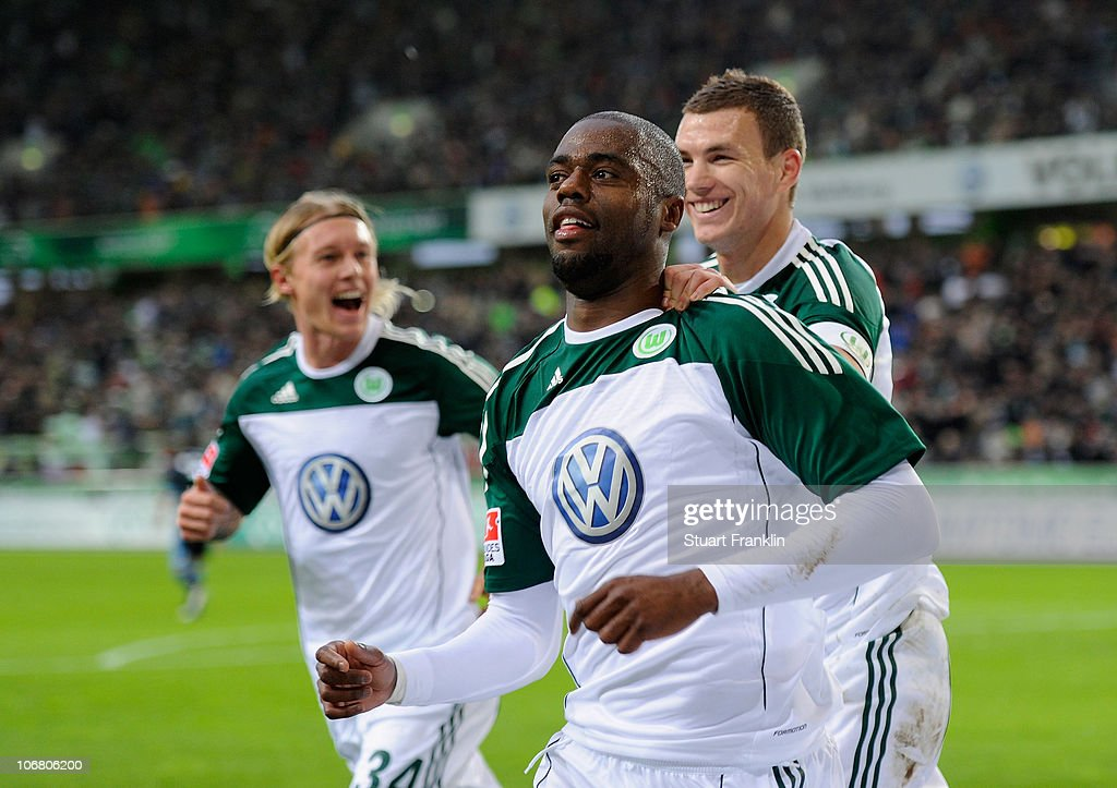 Grafite of Wolfsburg celebrates scoring the first goal with <a gi-track='captionPersonalityLinkClicked' href=/galleries/search?phrase=Edin+Dzeko&family=editorial&specificpeople=4404455 ng-click='$event.stopPropagation()'>Edin Dzeko</a> during the Bundesliga match between VfL Wolfsburg and FC Schalke 04 at Volkswagen Arena on November 13, 2010 in Wolfsburg, Germany.