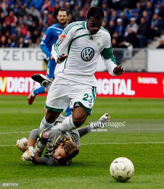 Grafite of Wolfsburg is challenged by goalkeeper Timo Hildebrand of Hoffenheim during the Bundesliga match between 1899 Hoffenheim and VfL Wolfsburg...