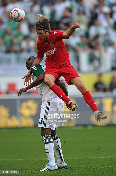 Grafite of Wolfsburg is challenged by v of Koeln during the Bundesliga match between VfL Wolfsburg and 1 FC Koeln at Volkswagen Arena on April 24...