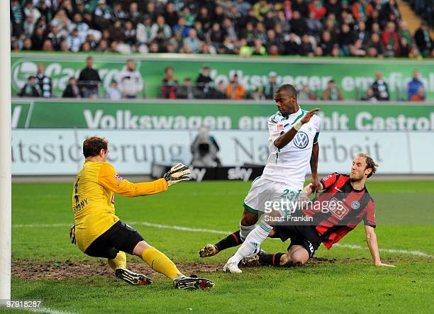 Grafite of Wolfsburg scores his team's first goal against goalkeeper Jaroslav Drobny of Hertha during the Bundesliga match between VfL Wolfsburg and...