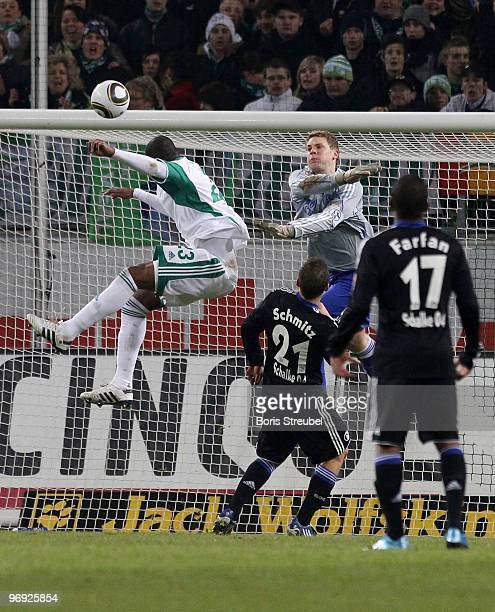 Grafite of Wolfsburg scores the second goal while goalkeeper Manuel Neuer Lukas Schmitz and Jefferson Farfan of Schalke react to late during the...
