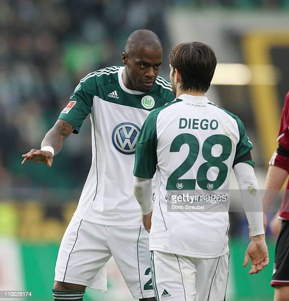 Grafite of Wolfsburg talks to his team mate Diego during the Bundesliga match between VfL Wolfsburg and 1 FC Nuernberg at Volkswagen Arena on March...