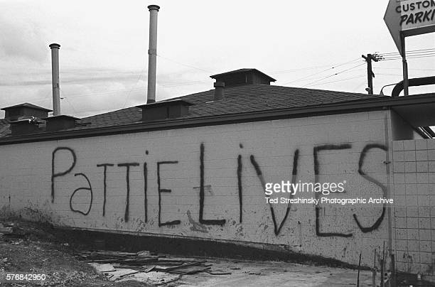 Grafitti on a wall says 'Pattie Lives' refering to Patricia Heast's kidnapping by the Symbionese Liberation Army