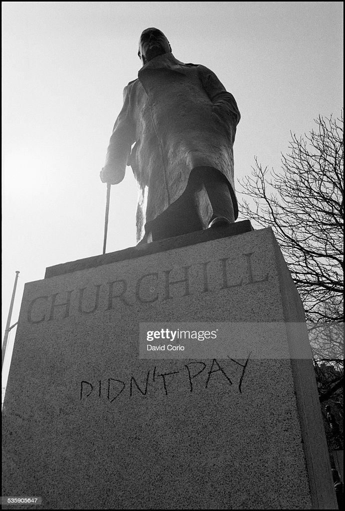 Grafitti on a Winston Churchill statue in Whitehall during a Poll Tax demonstration in the West End of London, UK, 31st March 1990.