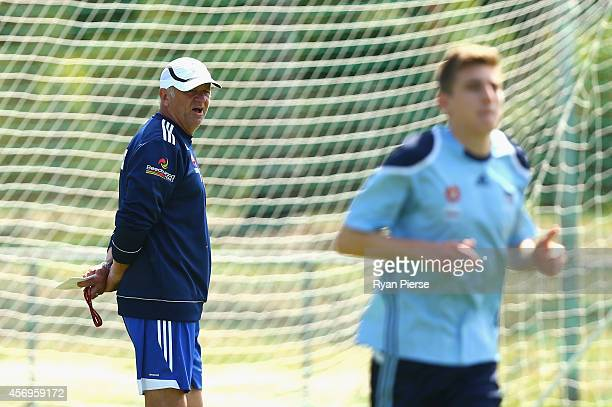 Graham Arnold coach of Sydney FC looks on during a Sydney Fc ALeague training session at Macquarie Uni on October 10 2014 in Sydney Australia