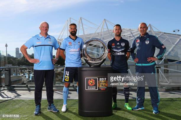 Graham Arnold head coach of Sydney Alex Brosque captain of Sydney Carl Valeri captain of the Victory and Kevin Muscat head coach of the Victory...