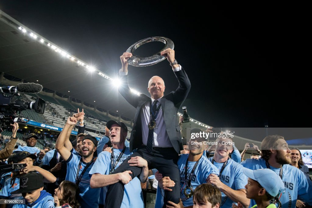 Graham Arnold of Sydney FC holds the A-League tropy up in front of the Cove during the 2017 A-League Grand Final match between Sydney FC and the Melbourne Victory at Allianz Stadium on May 7, 2017 in Sydney, Australia.