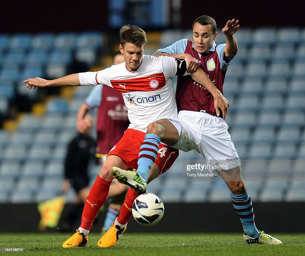 Graham Burke of Aston Villa (R) battles for the ball with Konstantinos Rougkalas of Olympiacos during the NextGen Series Quarter Final match between Aston Villa U19 and Olympiacos U19 at Villa Park on March 20, 2013 in Birmingham, England.