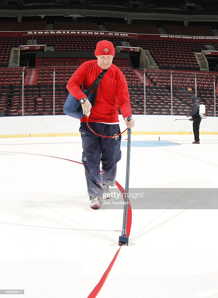 Graham Caplinger, head ice technician for the Florida Panthers paints one of the face off circles at the BB&T Center on January 14, 2013 in Sunrise, Florida.