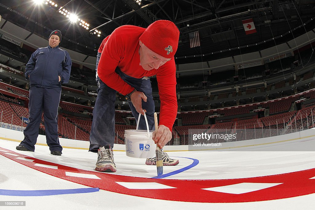 Graham Caplinger, head ice technician for the Florida Panthers supervises the painting of the lines and logos at the BB&T Center on January 14, 2013 in Sunrise, Florida.