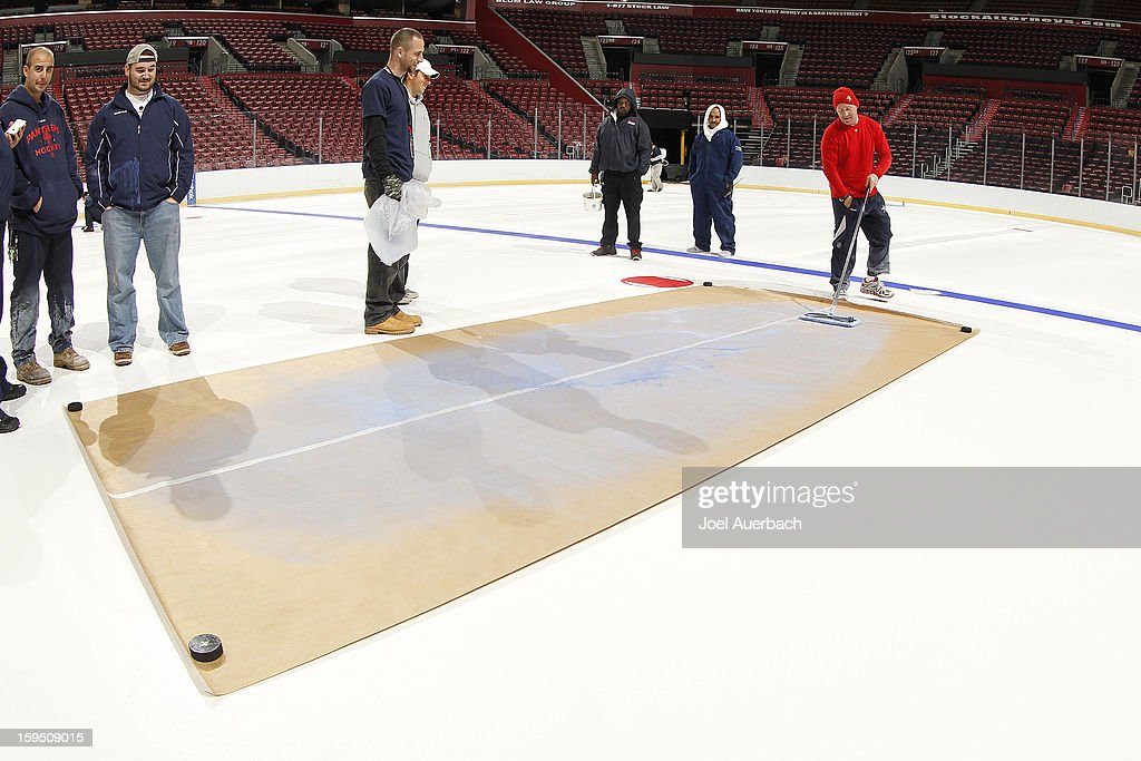 Graham Caplinger, head ice technician for the Florida Panthers uses a pattern to lay out the painting of the lines and logos at the BB&T Center on January 14, 2013 in Sunrise, Florida.