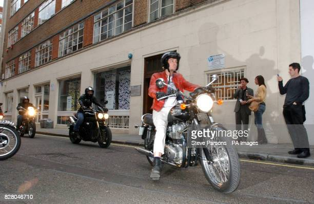 Graham Coxon arrives on his Triumph Bonneville T100 motorcycle at the world famous Ace Cafe central London for the launch of the Rockers Racers...