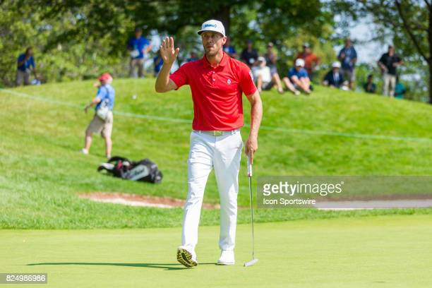 Graham DeLaet acknowledges the crowd after sinking his putt on the 9th hole during final round action of the RBC Canadian Open on July 30 at Glen...