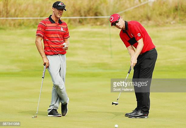 Graham Delaet and David Hearn of Canada look over a green during a practice round during Day 3 of the Rio 2016 Olympic Games at Olympic Golf Course...