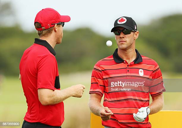 Graham Delaet and David Hearn of Canada wait on a tee box during a practice round during Day 3 of the Rio 2016 Olympic Games at Olympic Golf Course...