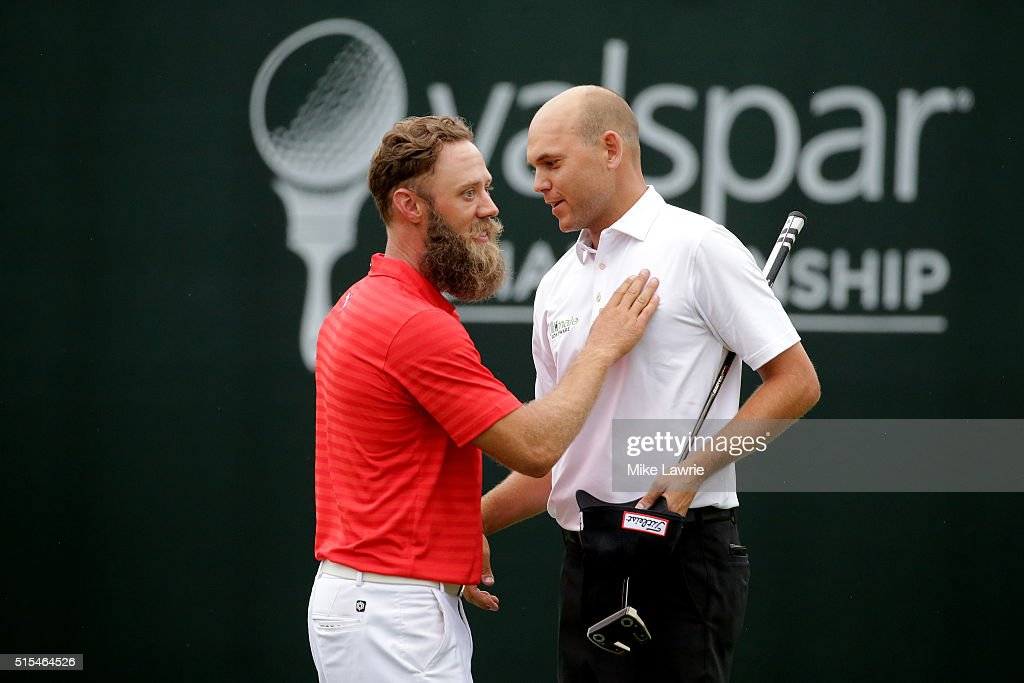 Graham DeLaet of Canada and Bill Haas shake hands after their round during the final round of the Valspar Championship at Innisbrook Resort...