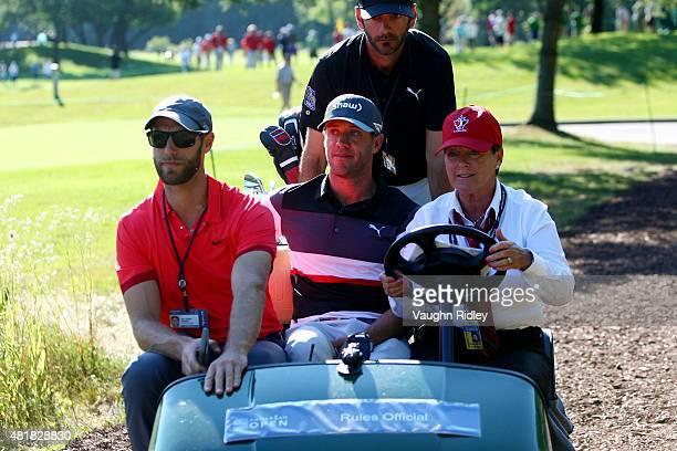 Graham DeLaet of Canada and his caddie ride in a golf cart after we withdrew do to injury during round two of the RBC Canadian Open on July 24 2015...