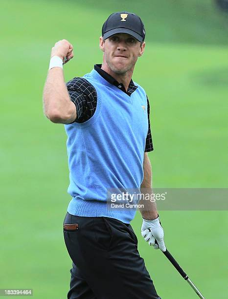 Graham DeLaet of Canada and the International Team reacts to holing a pitch shot for birdie on the 18th hole during the weatherdelayed Day Three...