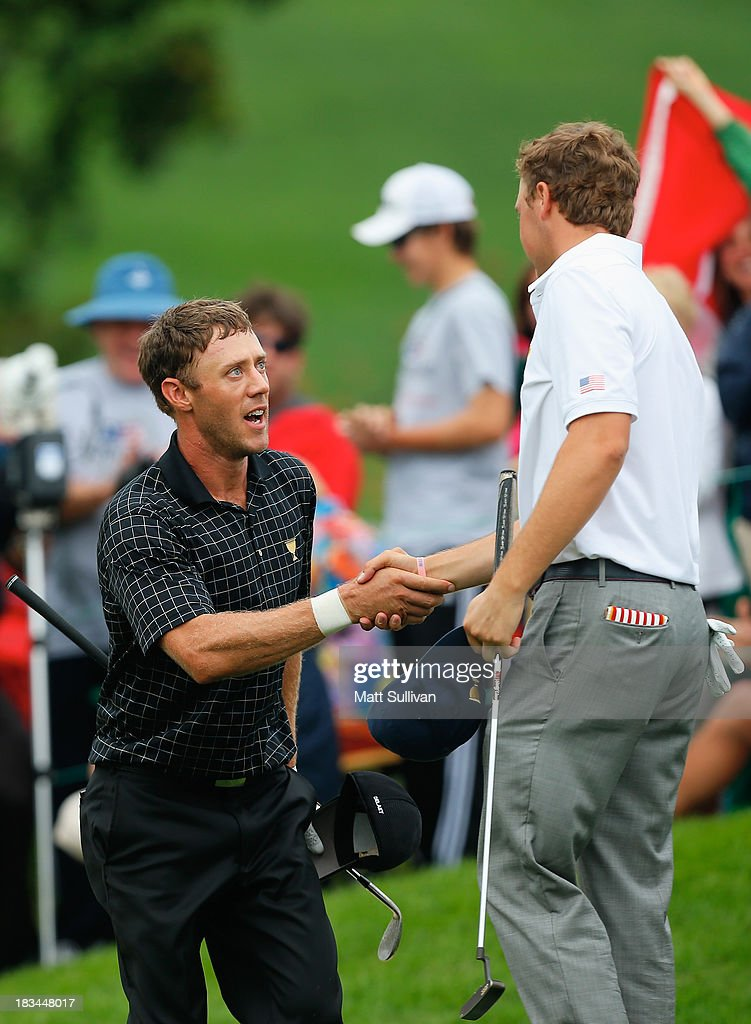 Graham DeLaet of Canada and the International Team (L) shakes hands with Jordan Spieth of the U.S. Team on the 18th green after DeLaet won the match 1up during the Day Four Singles Matches at the Muirfield Village Golf Club on October 6, 2013 in Dublin, Ohio.